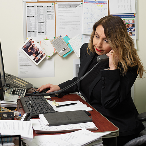 Citarella corporate employee sitting at a desk on the phone