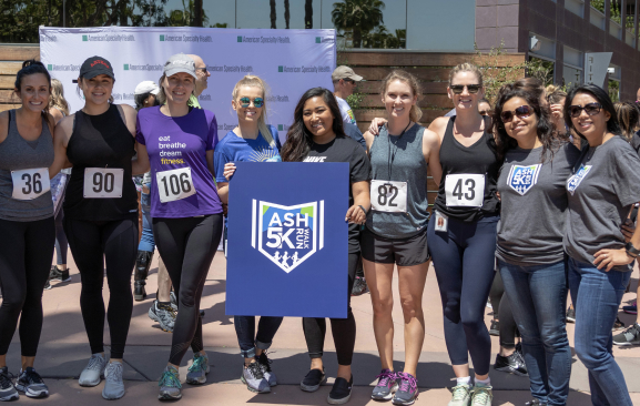 Group of employees posing for the ASH 5K run/walk
