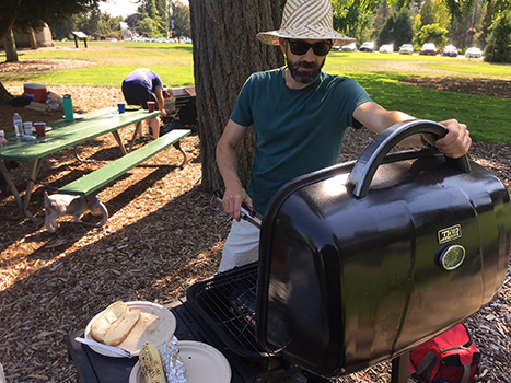 Man in a park grilling food